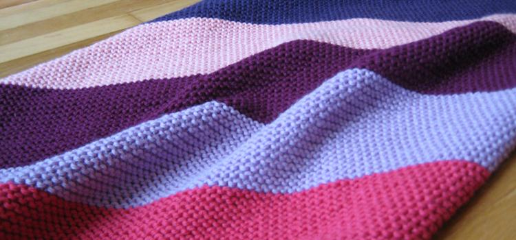 Garter stitch baby blanket.   Carbs & Fiber.